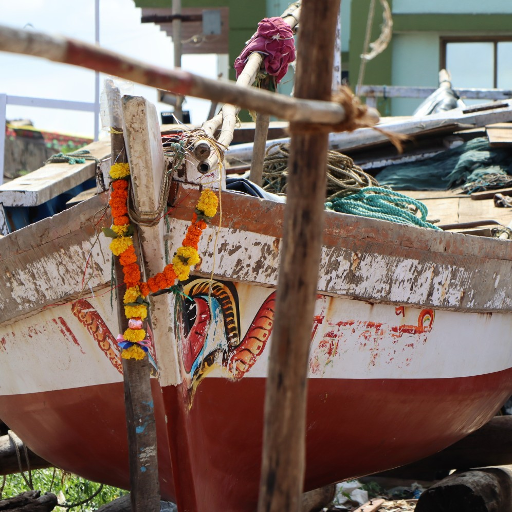 Fishing boats are adorned with garlands