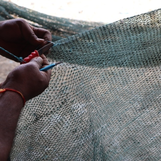 Mending old nets with a tool known as tasri